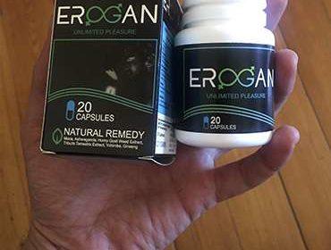Упаковка и капсулы от потенции Эроган в руке